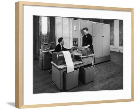 Man and a Women Working Together with a Pegasus Computer--Framed Art Print