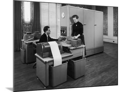 Man and a Women Working Together with a Pegasus Computer--Mounted Photographic Print