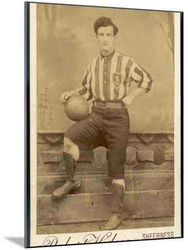 Anonymous Footballer in Kit with Football--Mounted Photographic Print