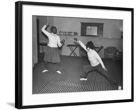 Two Waafs Fencing for Recreation During World War Ii-Robert Hunt-Framed Art Print