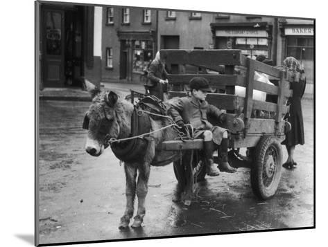 Small Boy Waits Patiently on a Donkey Cart in the Market Place at Kildare Co Kildare Ireland--Mounted Photographic Print