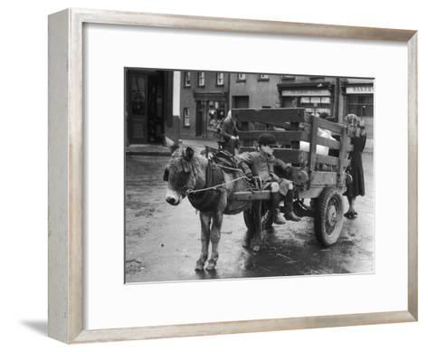 Small Boy Waits Patiently on a Donkey Cart in the Market Place at Kildare Co Kildare Ireland--Framed Art Print