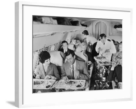 An Airline Steward and Air Hostess Serve a Roast Meal to Flight Passengers--Framed Art Print