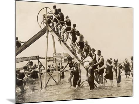 Bathers at Bournemouth Wait Their Turn for a Go on the Water Chute--Mounted Photographic Print