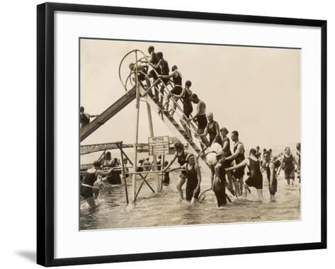 Bathers at Bournemouth Wait Their Turn for a Go on the Water Chute--Framed Art Print