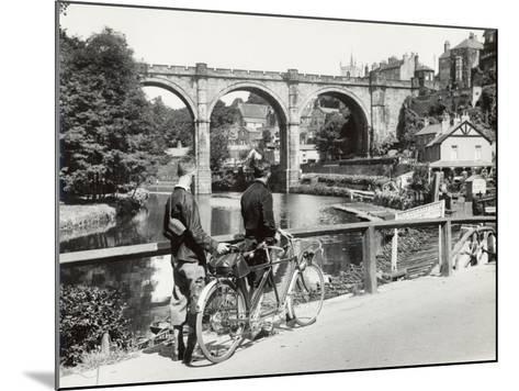 Two Cyclists Take a Break on a Bridge Over the River Nidd at Knaresborough-Fred Musto-Mounted Photographic Print