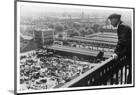 A Man Looks Down over the Old Caledonian Road Market, Caledonian Road, North London--Mounted Photographic Print