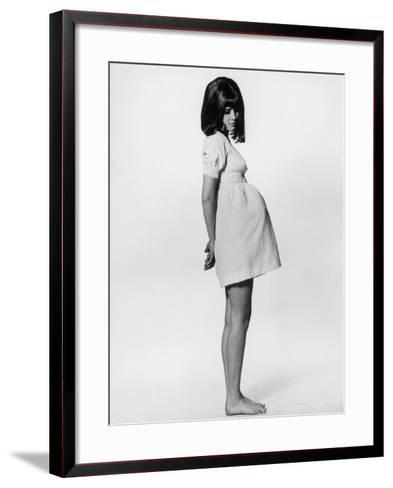 A Barefoot Pregnant Teenager in a Rather Unflattering Gingham Mini Maternity Dress--Framed Art Print