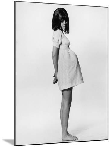 A Barefoot Pregnant Teenager in a Rather Unflattering Gingham Mini Maternity Dress--Mounted Photographic Print