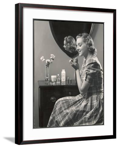 A Young Woman, Wearing a Madras Check Dress with Short Puff Sleeves, Paints Her Nails--Framed Art Print