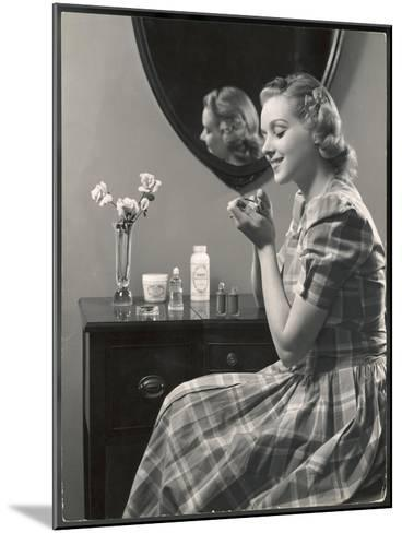 A Young Woman, Wearing a Madras Check Dress with Short Puff Sleeves, Paints Her Nails--Mounted Photographic Print