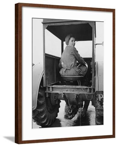 A Land Girl Driving a Tractor on a Farm During World War Ii-Robert Hunt-Framed Art Print