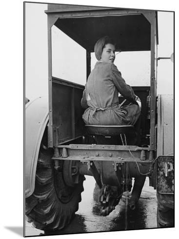 A Land Girl Driving a Tractor on a Farm During World War Ii-Robert Hunt-Mounted Photographic Print