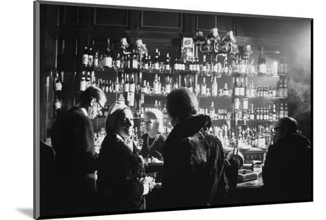 Barmaid in Smoky Pub--Mounted Photographic Print