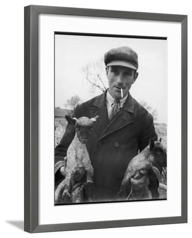 Farmer Holding His New Born Lambs in the Cotswolds-Henry Grant-Framed Art Print