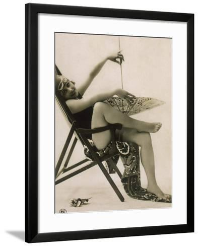 Attractive Woman Posing in Her Swimsuit in a Deckchair, with a Parasol--Framed Art Print