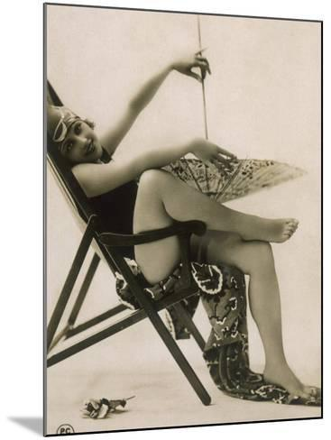 Attractive Woman Posing in Her Swimsuit in a Deckchair, with a Parasol--Mounted Photographic Print