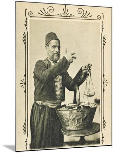 A Pistachio Nut Seller from Izmir (Smyrna), Turkey--Mounted Photographic Print
