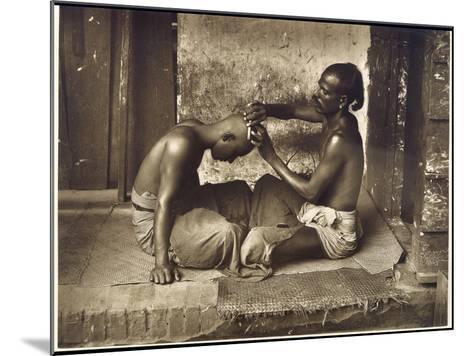 A Barber at Work in Ceylon (Sri Lanka)--Mounted Photographic Print