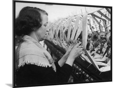 A Woman Working in a Silk and Rayon Mill, Burnley, Lancashire, Britain-Henry Grant-Mounted Photographic Print