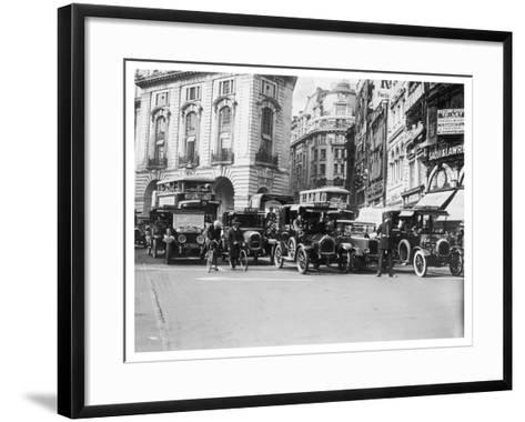 Policeman Directs Traffic Through Piccadilly Circus--Framed Art Print
