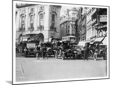 Policeman Directs Traffic Through Piccadilly Circus--Mounted Photographic Print