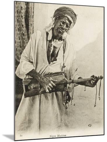 A Black Algerian Musician--Mounted Photographic Print