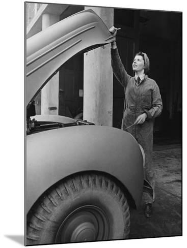 A Land Girl Mechanic Working on a Car During World War Ii-Robert Hunt-Mounted Photographic Print