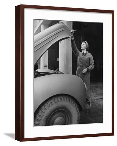 A Land Girl Mechanic Working on a Car During World War Ii-Robert Hunt-Framed Art Print