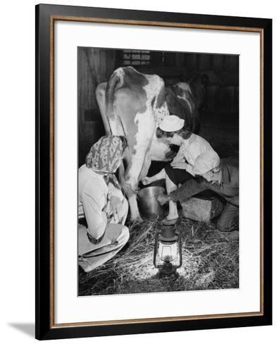 Land Girls Millking Cows on a Farm During World War II-Robert Hunt-Framed Art Print