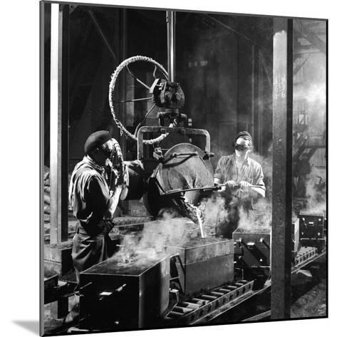 Molten Metal on a Production Line-Heinz Zinram-Mounted Photographic Print