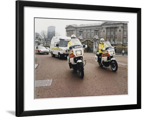 Metropolitan Police Motorcyclists Esccorting an Ambulance Past Buckingham Palace in London--Framed Art Print