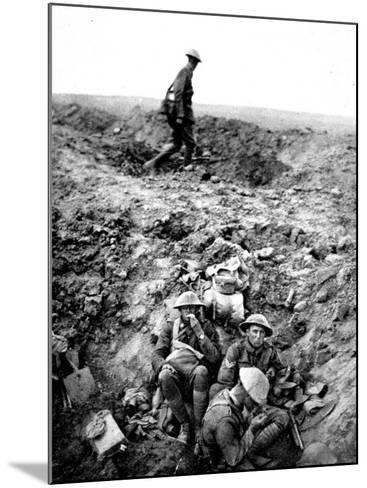 New Zealand Soldiers Resting in Shell-Hole--Mounted Photographic Print