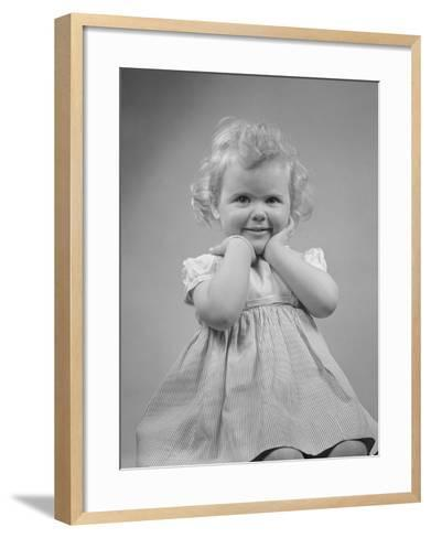Baby Girl Smiling with Hands Next to Face--Framed Art Print