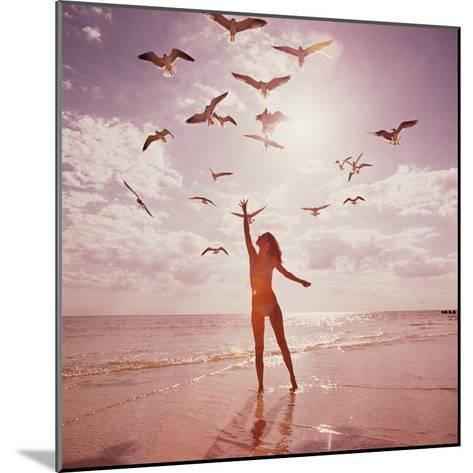 Woman Feeding Seagulls-Dennis Hallinan-Mounted Photographic Print