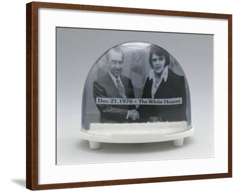 Close-Up of Figurines of Elvis Presley and Richard Nixon with Handshake in a Snow Globe--Framed Art Print