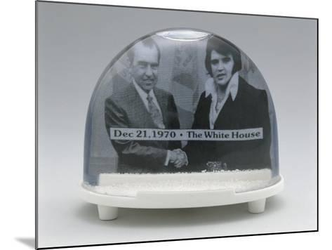 Close-Up of Figurines of Elvis Presley and Richard Nixon with Handshake in a Snow Globe--Mounted Photographic Print