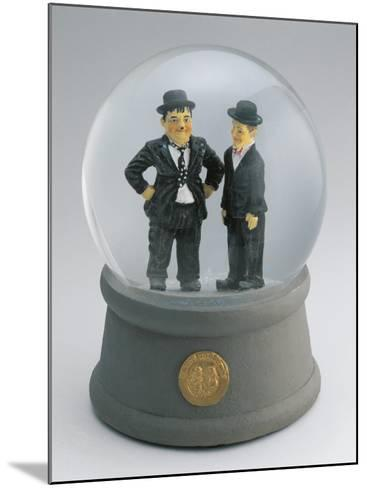 Close-Up of Figurines of Laurel and Hardy in a Snow Globe--Mounted Photographic Print