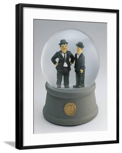 Close-Up of Figurines of Laurel and Hardy in a Snow Globe--Framed Art Print