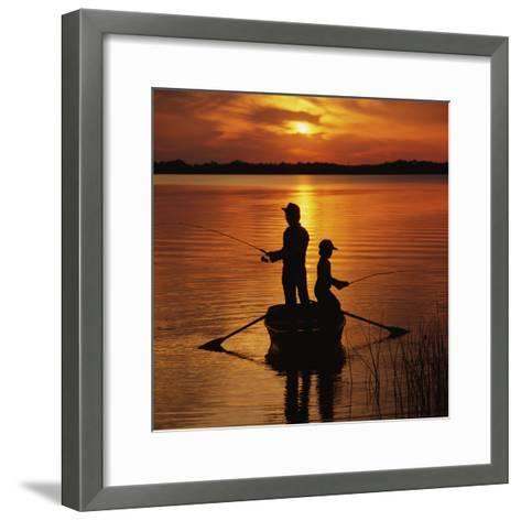 Silhouette of Father and Son Fishing at Sunset-Dennis Hallinan-Framed Art Print