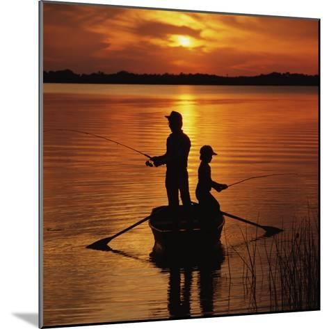 Silhouette of Father and Son Fishing at Sunset-Dennis Hallinan-Mounted Photographic Print