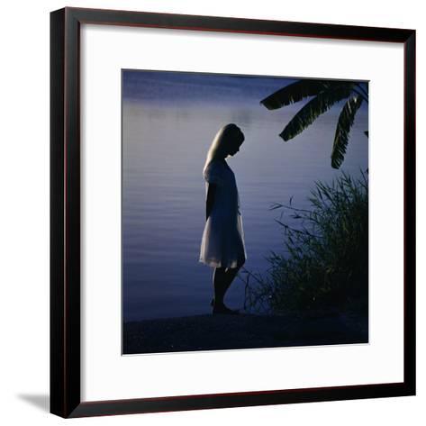 Silhouette of woman standing near a lake-Dennis Hallinan-Framed Art Print