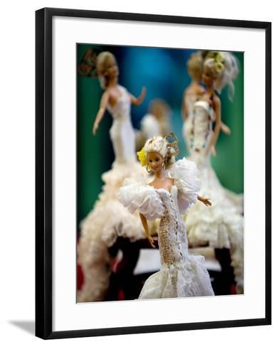 One of the two hundred Barbie dolls dressed in traditional flamenco outfits--Framed Art Print