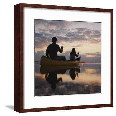 Couple Rowing Canoe in Lake at Sunset-Dennis Hallinan-Framed Art Print