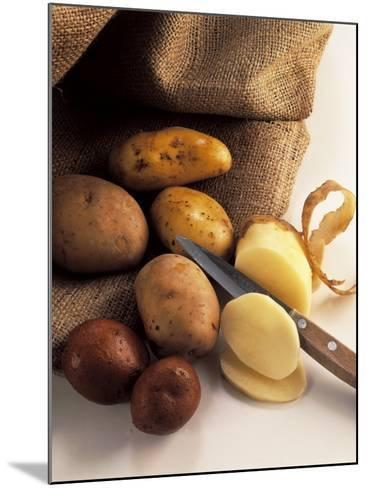 High Angle View of Raw Potatoes with a Knife-P^ Martini-Mounted Photographic Print