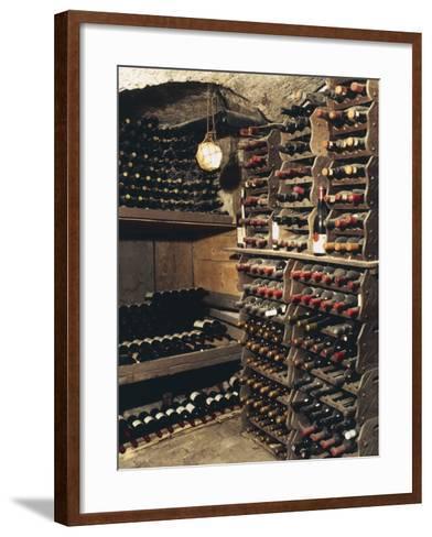 Wine Bottles on a Rack in a Wine Cellar-G^ Cigolini-Framed Art Print