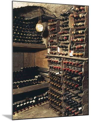 Wine Bottles on a Rack in a Wine Cellar-G^ Cigolini-Mounted Photographic Print
