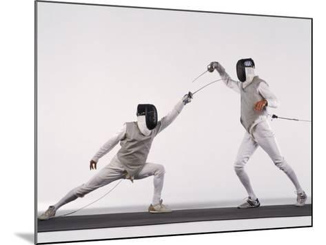 Male Fencer Making Lunging Attack in Foil--Mounted Photographic Print