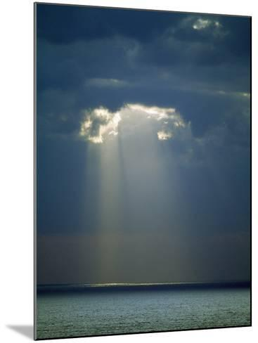Sun Rays Reaching the Sea Through the Clouds--Mounted Photographic Print
