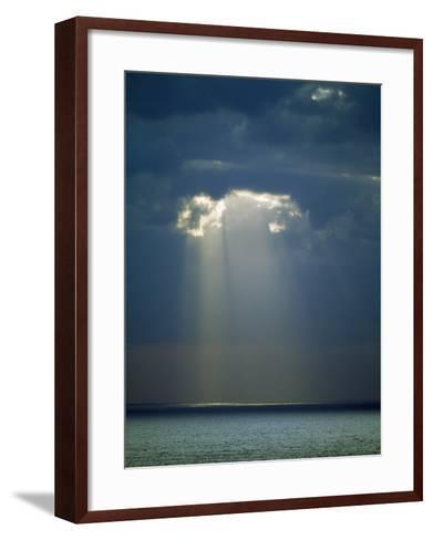 Sun Rays Reaching the Sea Through the Clouds--Framed Art Print